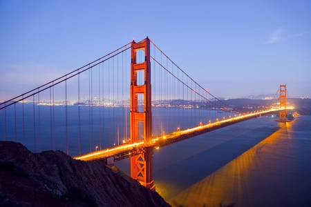 bridges: Golden Gate Bridge at Night with San Francisco Skyline, long exposure Stock Photo