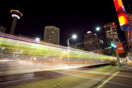 alberta: Traffic moving through downtown Calgary at night