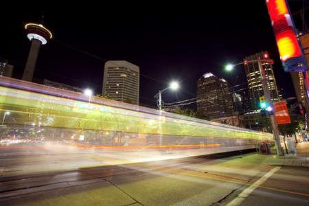Traffic moving through downtown Calgary at night photo