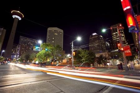 Traffic moving through downtown Calgary at night