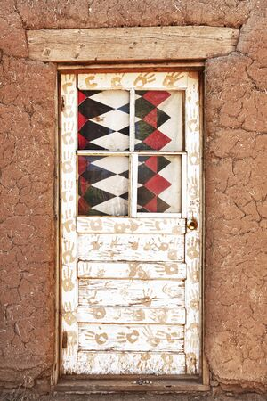adobe pueblo: Decorated Door and Adobe Building, Taos Pueblo