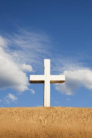 White Cross on Adobe Wall, San Francisco de Asis, Mission Church, Ranchos de Taos, New Mexico, USA Stock Photo