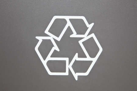 reprocess: Recycle Symbol on grey background, environmental close-up