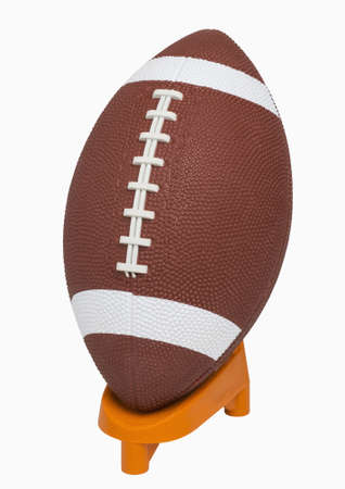 includes: Football on tee, isolated on white, includes clipping path