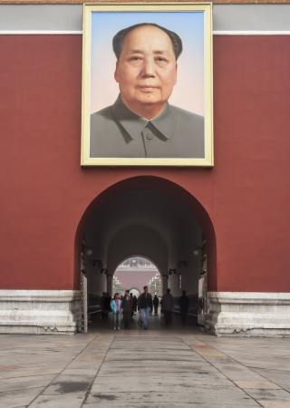 Unidentifiable tourists walk through the Tiananmen Gate of Heavenly Peace under the Portrait of Mao, Forbidden City, Beijing, China
