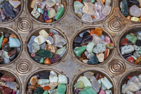 Polished stones in antique metal baking tray