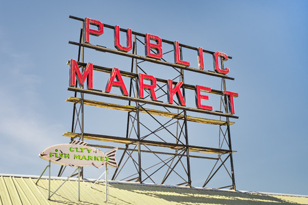 Neon public market sign against sky, Pikes Place Market in Seattle, Washington Editorial