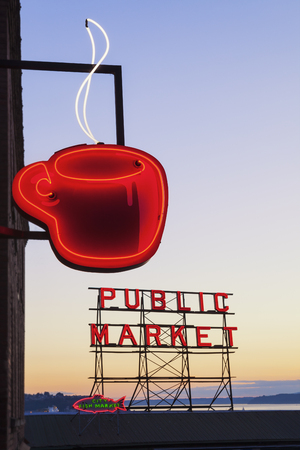 Neon coffee cup and public market sign in Seattle, Washington