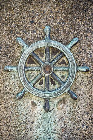 Ships steering wheel decoration on concrete wall, Seattle, Washington Stock Photo - 22998589