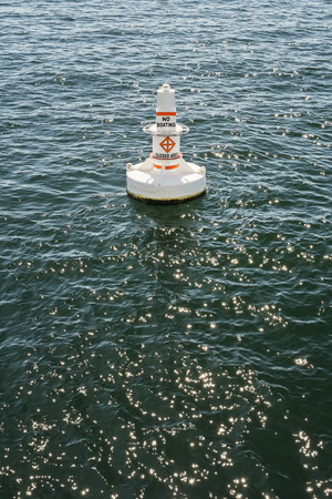 Buoy in harbor showing area off limits to boaters, Seattle, Washington Stock Photo - 22998617
