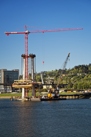 Crane building light rail bridge over the Willamette River, Portland, Oregon photo