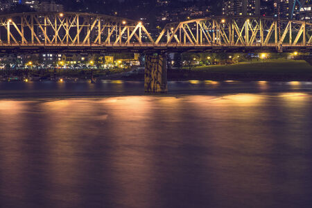 willamette: Hawthorne Bridge crosses over the Willamette River at night, Portland, Oregon