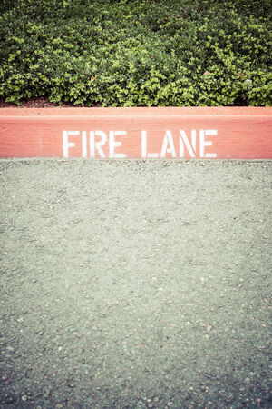 curb: Curb with Fire Lane painted on Stock Photo