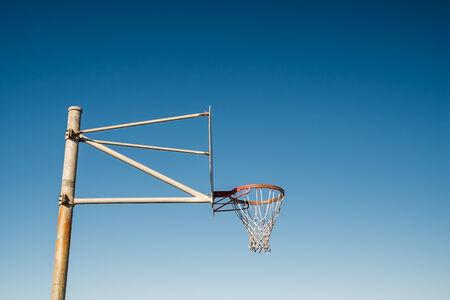 basketball hoop: Side view of a basketball hoop against blue sky