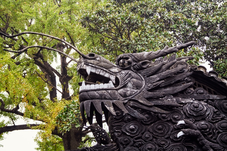 Chinese Dragon on the roof in Yuyuan Garden  Shanghai, China photo