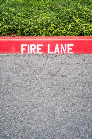 Curb with Fire Lane painted on Stock Photo
