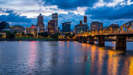 portland oregon: Colorful lights reflecting off the Willamette River in Downtown Portland, Oregon Editorial