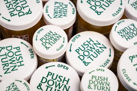 drug overdose: Childproof tops of many prescription bottle of medication
