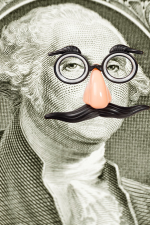 the novelty: Novelty Glasses and Mustache on George Washington face  Close-up of one dollar bill