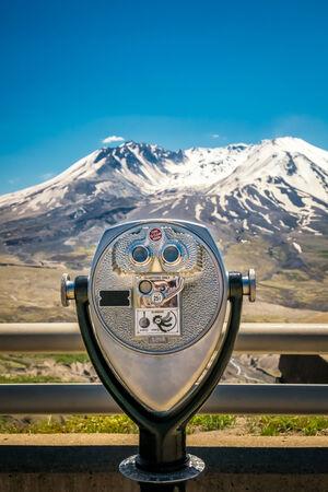 binoculars view: Coin operated binoculars in front of Mount Saint Helens