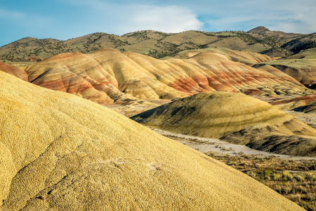 The Painted Hills Unit contains colorful geological layers of strata. The Painted Hills are located in John Day Fossil Beds National Monument in Eastern Oregon