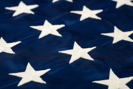 embroidered: Closeup of the white stars embroidered on the American flag Stock Photo