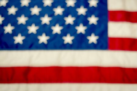 red white blue: A blurred image of the American flag is an excellent background image Stock Photo