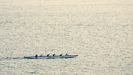 outrigger: An outrigger canoe team practices rowing in the protected harbor waters of Lahaina, Maui