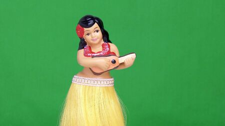 leis: Dancing Hula girl doll against a green screen Stock Photo