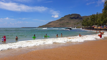 Tourists and locals swim at Kalapaki Beach in the town of Nawiliwili on the island of Kauai