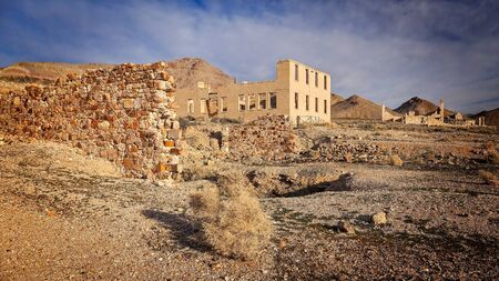 near death: Ruins of the Rhyolite ghost town near Death Valley Stock Photo