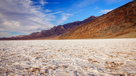 valley below: The salt flats in Badwater Basin in Death Valley National Park. Badwater Basin in the lowest point in North America at 282 feet below sea level.