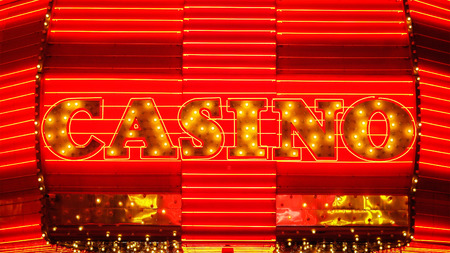 sin city: The word casino is lit up in neon lights at night on Fremont Street in Las Vegas