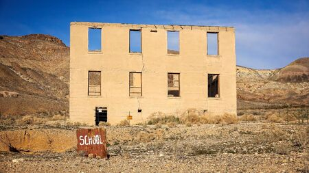 near death: Ruins of the Rhyolite ghost town school near Death Valley Stock Photo