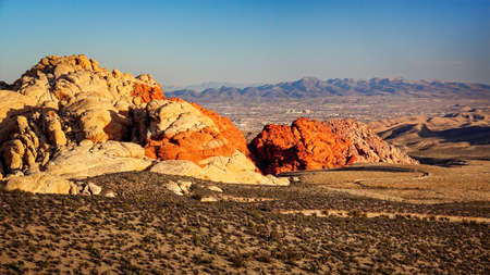 red america: Red Rock Canyon with a view of Las Vegas in the distance
