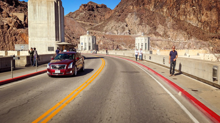 hoover dam: A view from inside a car as it drives across the Hoover Dam
