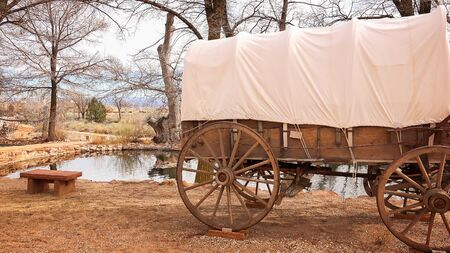 covered wagon: Covered wagon sits next to collected natural spring water at Pipe Spring National Monument
