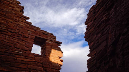 hopi: American indian ruins at Wupatki National Monument stand in silhouette against the sky