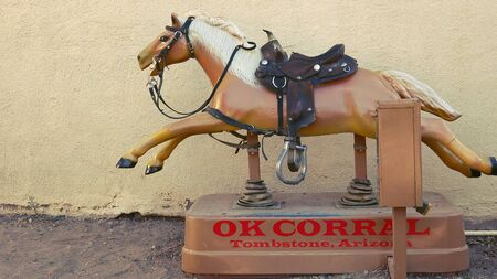 kiddie: Coin-operated horse ride runs at the OK Corral in Tombstone, Arizona Editorial