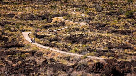 chihuahua desert: Visitors on the curved walkway through lava fields at Valley of Fires Recreation Area in New Mexico