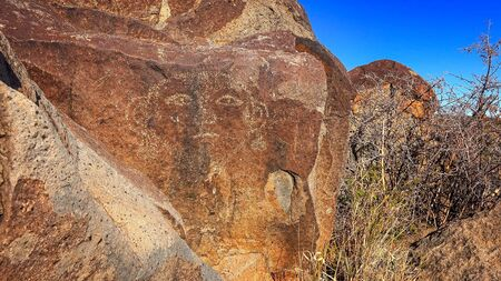chihuahua desert: Face petroglyph carved into rock at Three Rivers Petroglyph Site in New Mexico