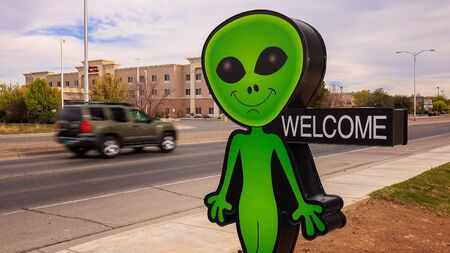 ufology: Little green alien and welcome sign welcomes visitors to a business in Roswell, New Mexico