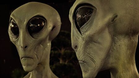 ufology: Alien faces with big eyes at the International UFO Museum and Research Center in Roswell, New Mexico