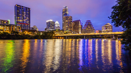 City lights come on in Austin, Texas downtown skyline at night