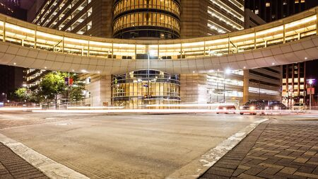 Busy intersection in downtown Houston, Texas at night with traffic Editorial