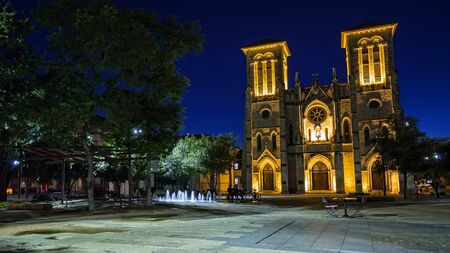 Water fountain and San Fernando Cathedral in San Antonio, Texas at night