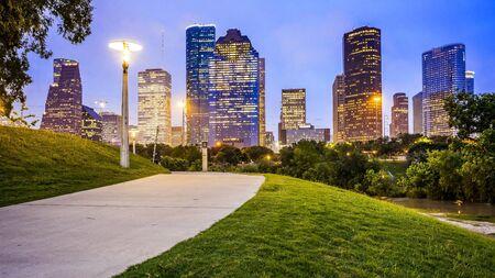 Houston city skyline as night falls and Eleanor Tinsley Park Editorial