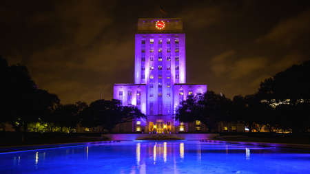 pool hall: Houston, Texas City Hall building lit up at night with reflecting pool Editorial
