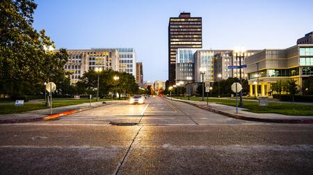 Street in downtown Baton Rouge, Louisiana as night falls - skyline