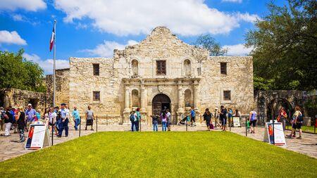 Exterior view of the historic Alamo in San Antonio, Texas with tourists, timelapse